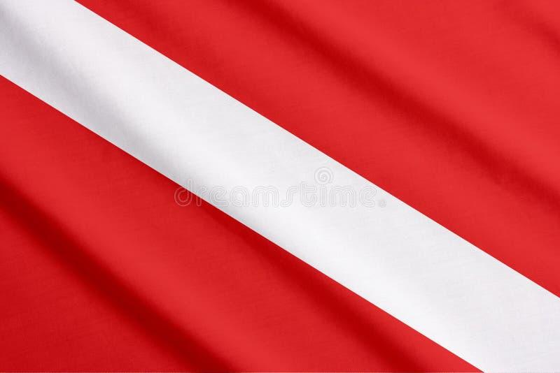 El agitar de la bandera del equipo de submarinismo foto de archivo