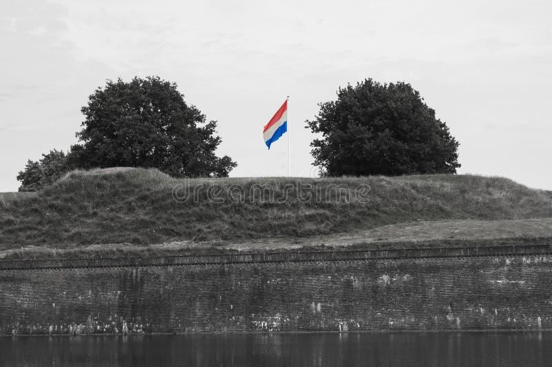 El agitar holandés de la bandera fotografía de archivo