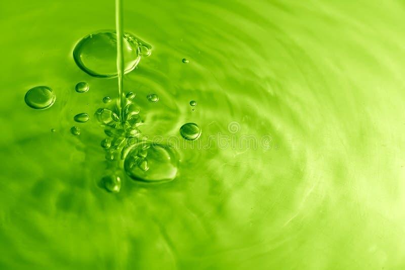El agua burbujea V foto de archivo