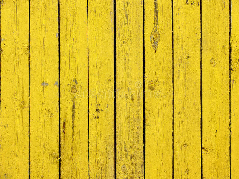 El amarillo coloreó el viejo fondo de madera de la textura del tablón imagen de archivo