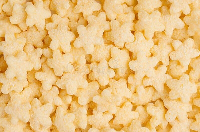 El amarillo protagoniza el fondo del primer de las avenas, textura de los cereales Visión superior fotografía de archivo