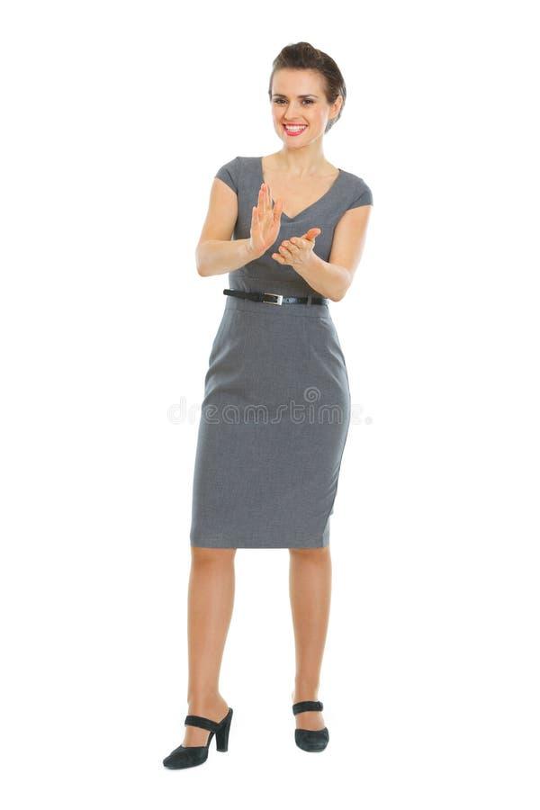 El aplaudir de la mujer de negocios foto de archivo libre de regalías