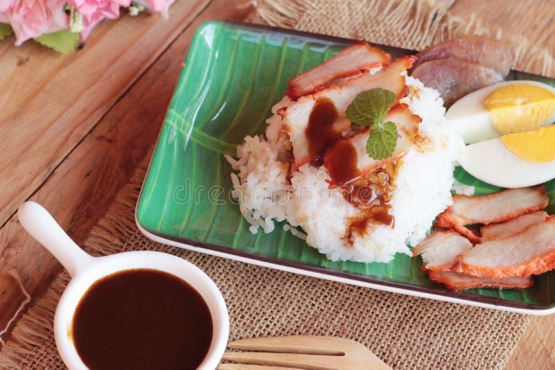 El arroz asado del cerdo con salsa es delicioso fotografía de archivo libre de regalías