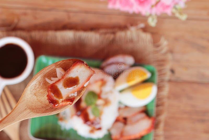 El arroz asado del cerdo con salsa es delicioso fotografía de archivo
