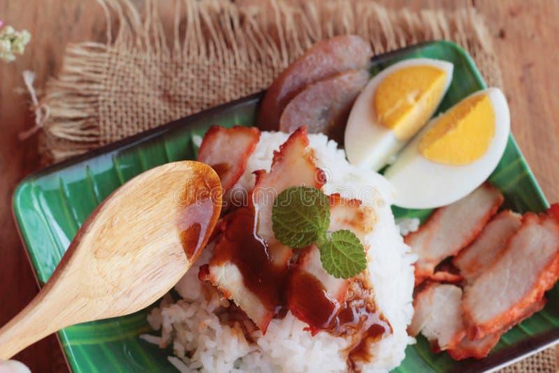 El arroz asado del cerdo con salsa es delicioso foto de archivo