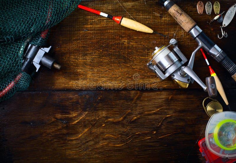 El arte se divierte la caña de pescar y el fondo de los trastos fotografía de archivo libre de regalías