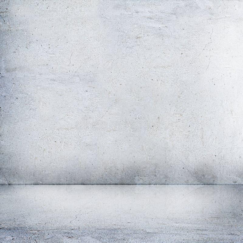El ascendente cercano gris del muro de cemento y del piso imagen de archivo libre de regalías