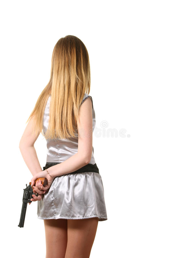 El asimiento de la mujer un revólver imagen de archivo libre de regalías