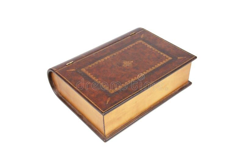 El ataúd confidencial cerrado bajo la forma de libro en una pizca imagenes de archivo