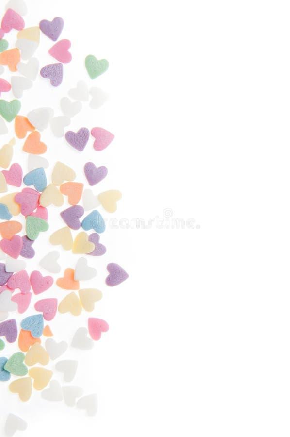 El azúcar asperja los corazones de los puntos, decoración para la torta y panadería, como fondo stock de ilustración