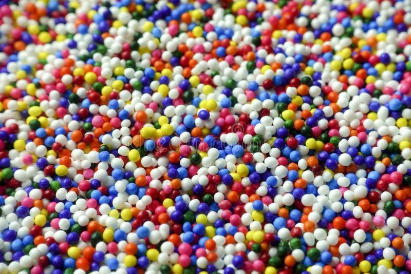 El azúcar colorido asperja las decoraciones de la torta foto de archivo libre de regalías
