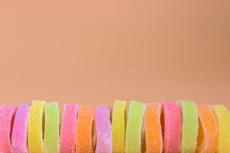 El azúcar colorido de la mezcla de la jalea rueda para arriba imagen de archivo libre de regalías