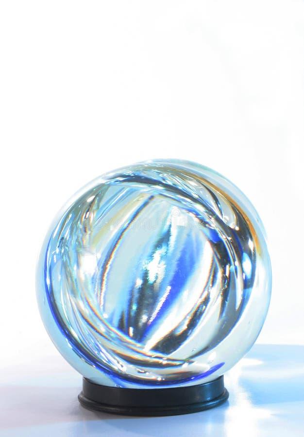 El azul de la bola de cristal enciende withi fotos de archivo