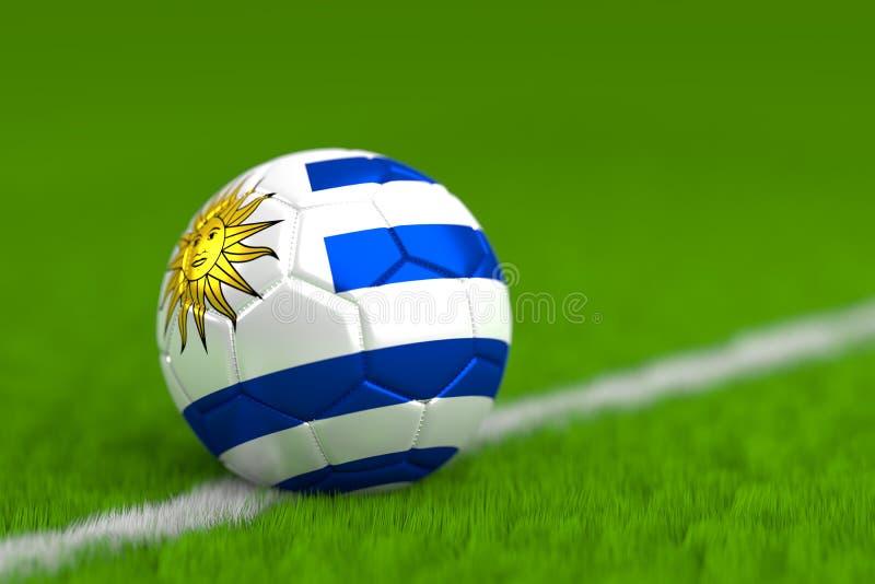 El balón de fútbol con la bandera uruguaya 3D rinde fotografía de archivo libre de regalías
