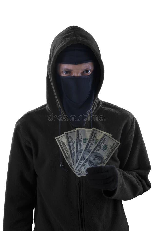 El bandido de sexo masculino sostiene el dinero robado fotografía de archivo
