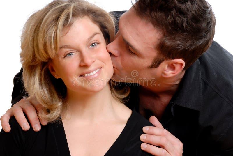 El besarse fotografía de archivo