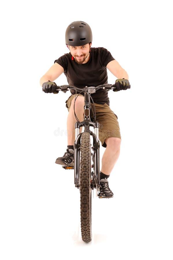 El bicyclist en blanco foto de archivo