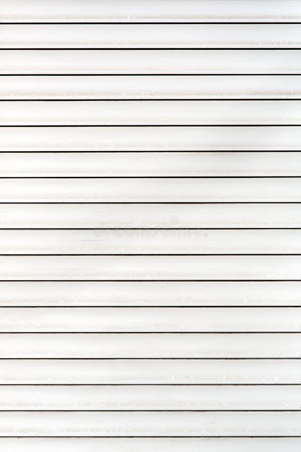 El blanco horizontal de la persiana enrrollable imagen de archivo