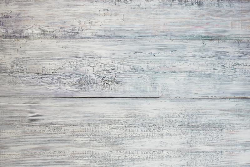 El blanco lamentable resistido vintage, azul pintó la textura de madera como fondo foto de archivo