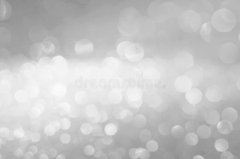 El bokeh de la falta de definición resume el fondo blanco o gris fotografía de archivo libre de regalías