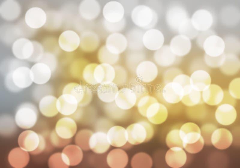 El bokeh marrón y blanco del oro enciende defocused abstraiga el fondo foto de archivo libre de regalías