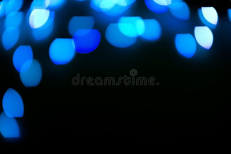 El brillo azul enciende el fondo defocused imágenes de archivo libres de regalías