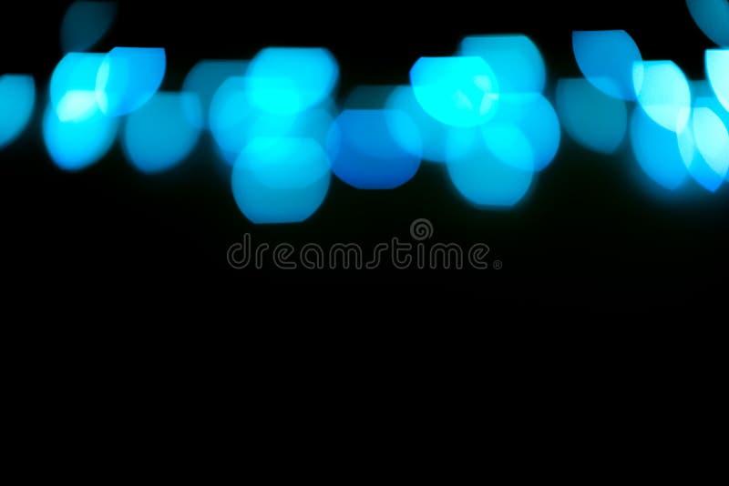 El brillo azul enciende el fondo defocused stock de ilustración