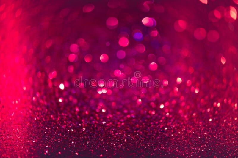 El brillo del rojo y del rosa resume el fondo con el bokeh defocused foto de archivo