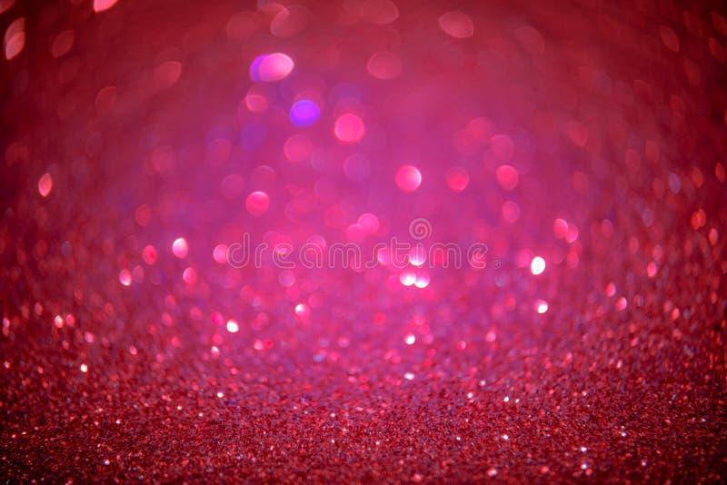 El brillo del rojo y del rosa resume el fondo con li defocused del bokeh fotos de archivo