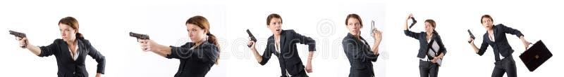 El businewoman de la mujer con el arma de la mano fotografía de archivo