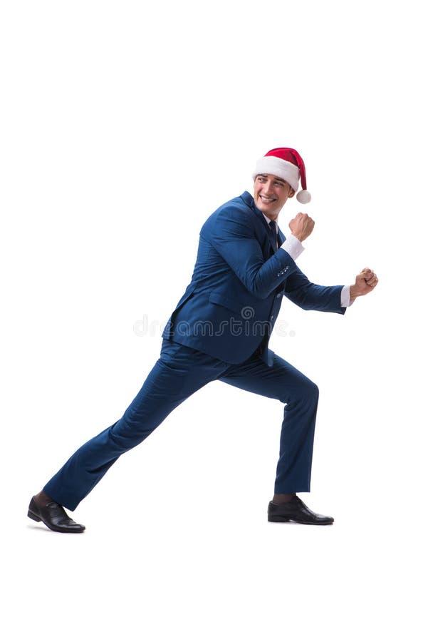 El busnessman joven que lleva el sombrero de santa en concepto de la Navidad en blanco fotografía de archivo
