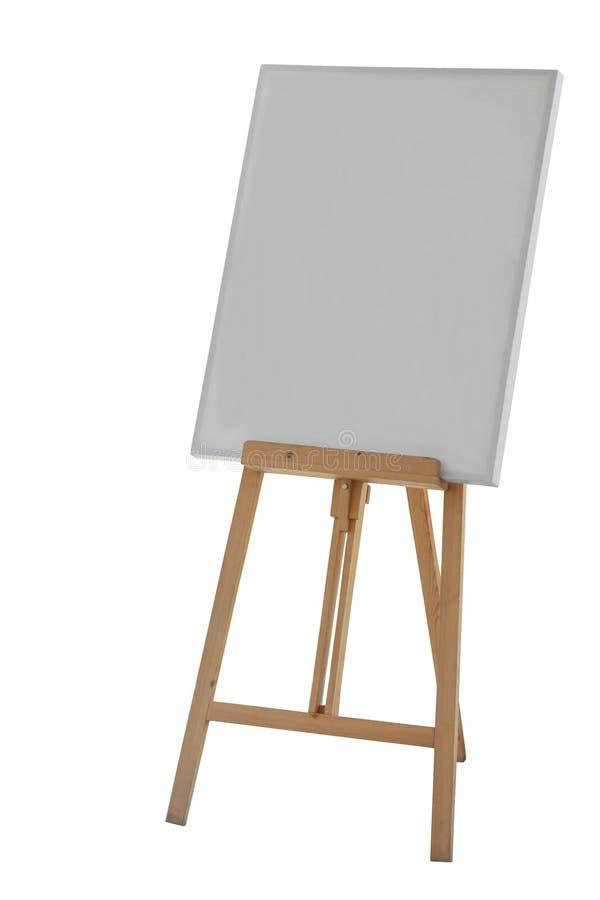 El caballete de madera de pintura del soporte con el cartel en blanco de la lona firma al tablero imagen de archivo libre de regalías
