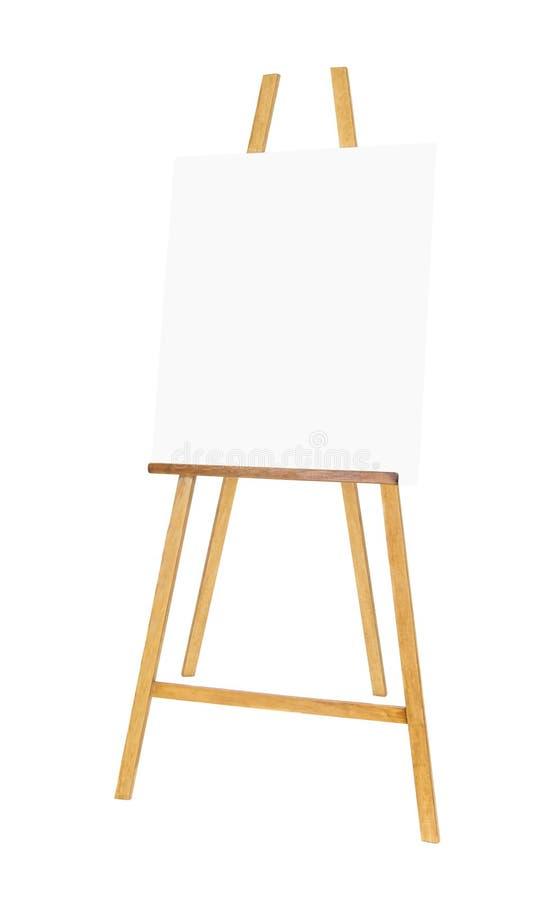 El caballete de madera de pintura del soporte con el cartel en blanco de la lona firma al tablero fotografía de archivo libre de regalías