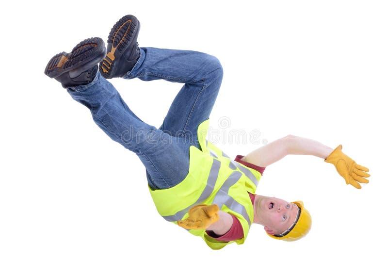 El caer del trabajador de construcción fotos de archivo