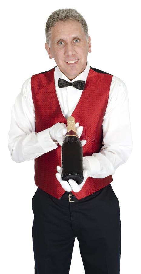 El camarero principal de lujo Holding Wine Bottle aisló fotografía de archivo