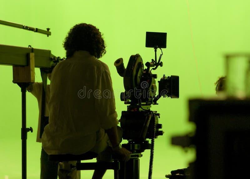 El cameraman encendido greenscreen fotografía de archivo
