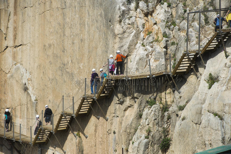 El caminito del Rey. ARDALES (MALAGA), SPAIN - APRIL 17: Tourists walk along the 'El Caminito del Rey' (King's Little Path), World's Most Dangerous Footpath stock photography