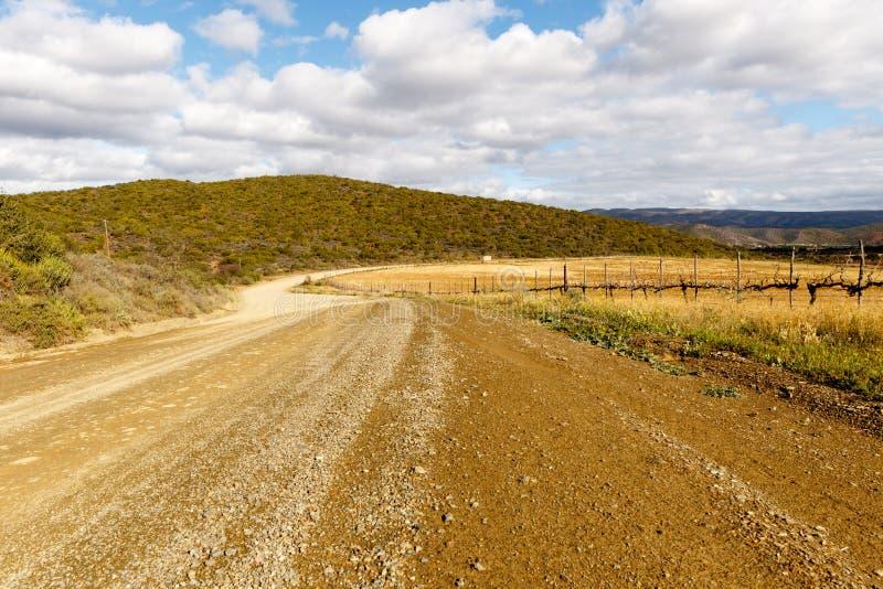 El camino a Plaas medio - De Rust imagenes de archivo