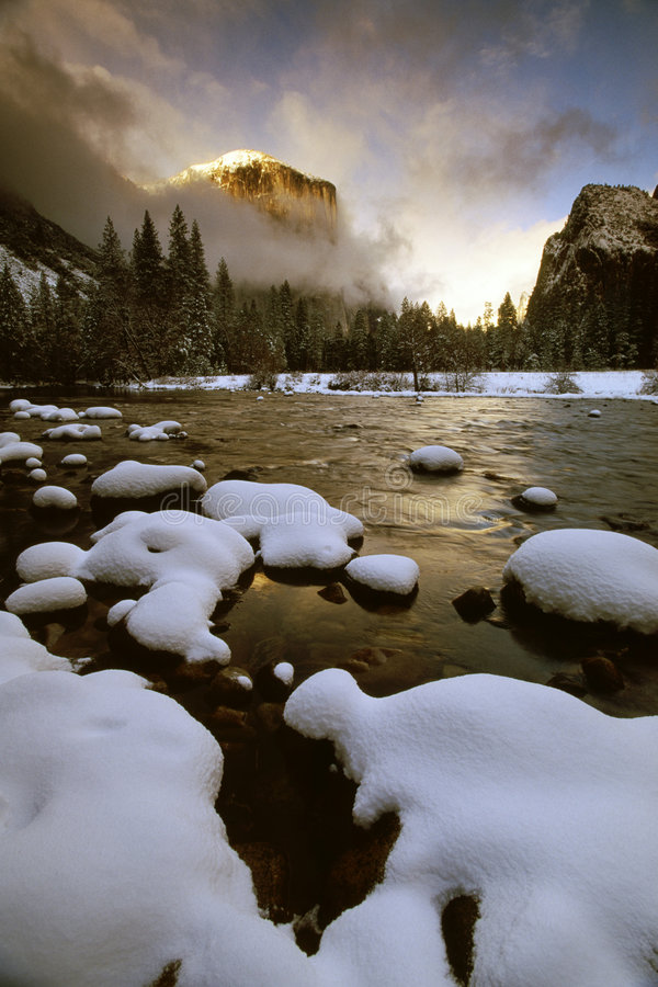 El Capitan in clearing winter. El Capitan in sunset, while winter storm clearing, Yosemite National Park royalty free stock photo
