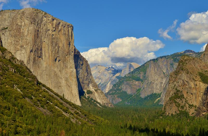 El Capitan. In Yosemite National Park in California with white puffy clouds in the sky royalty free stock image