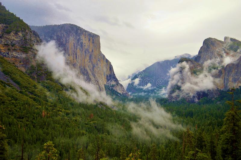 El Capitan. In Yosemite National Park in California with white puffy clouds in the sky stock photos