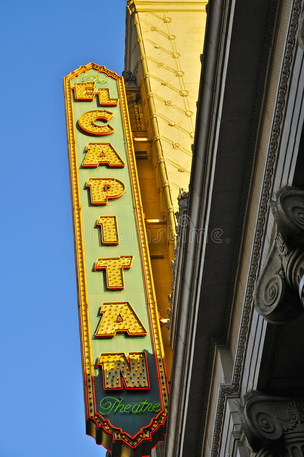 El Capitan Neon Sign in clear blue sky. Vintage Neon Sign of The El Capitan Theatre; Hollywood Boulevard, CA stock photo