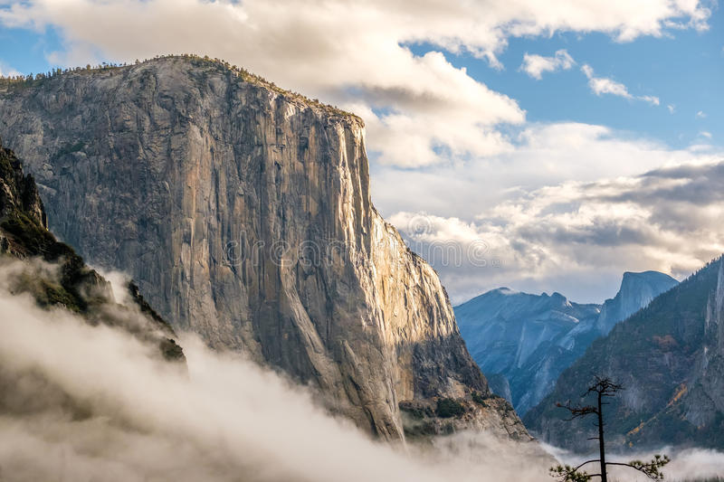 El Capitan rock in Yosemite National Park. El Capitan rock close-up in Yosemite National Park Valley at cloudy autumn morning from Tunnel View. Low clouds lay in royalty free stock photo