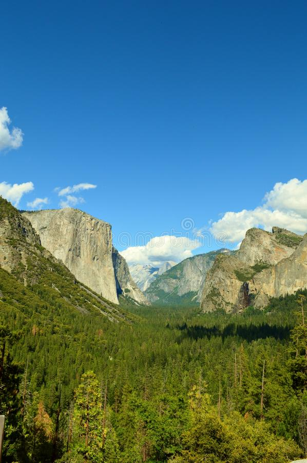 El Capitan. In Yosemite National Park in California with white puffy clouds in the sky stock photography