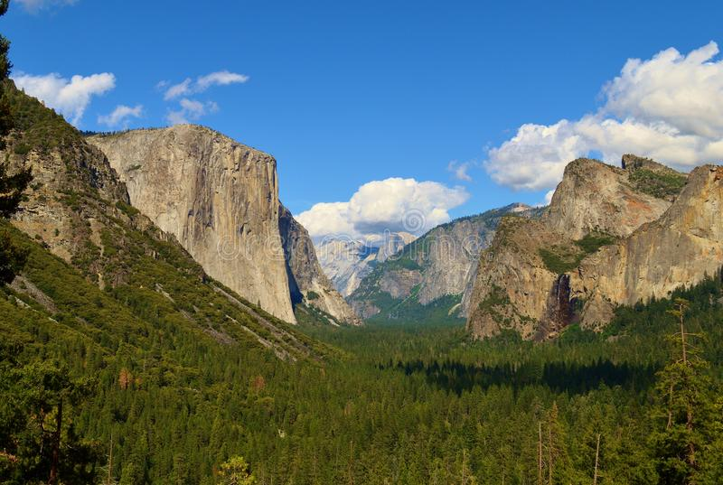 El Capitan. In Yosemite National Park in California with white puffy clouds in the sky stock images