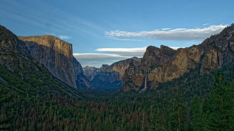 El Capitan and Yosemite tunnel view. The Yosemite National Park tunnel view and the El Capitan rock formation lit by the sunset stock image