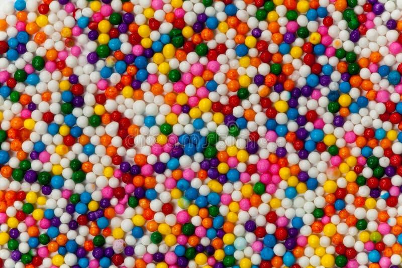El caramelo colorido asperja fotos de archivo