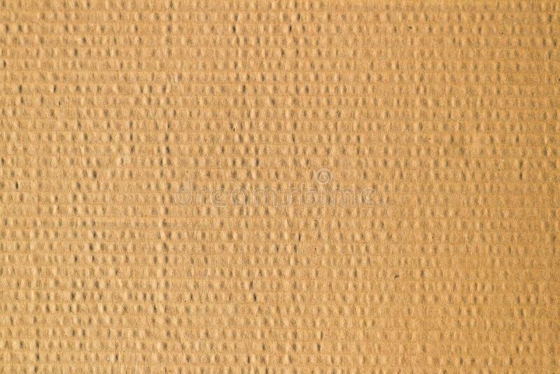 El cartón de Brown acanala el uso de la textura para el fondo imagenes de archivo