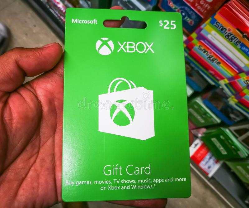 El carte cadeaux de Xbox es la manera rápida y fácil de comprar juegos, películas, showes televisivo, música, apps y más en Xbox  foto de archivo libre de regalías