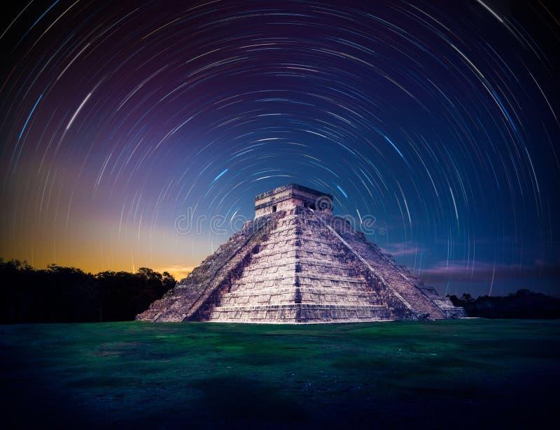 El Castillo pyramid in Chichen Itza, Yucatan, Mexico, at night with star trails stock photography